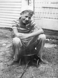 Boy Sitting a Very Small Wagon, Ca. 1938 Photographic Print