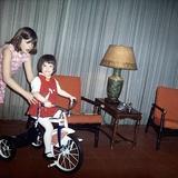 Older Sister Helps Her Sister with New Bike, Ca. 1967 Reprodukcja zdjęcia