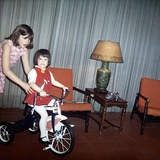 Older Sister Helps Her Sister with New Bike, Ca. 1967 Photographic Print