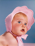 1960s Very Cute Blue Eyed Baby Wearing Pink White Checked Bonnet Looking Up Photographic Print