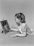 1940s Child Little Girl Looking at Framed Picture of Her Father a Soldier in Uniform Photographic Print