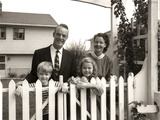 1950s Family of Four Behind Picket Fence Photographic Print