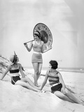 1920s Three Smiling Women in Swimsuits at the Beach Two Sitting One Standing Holding an Umbrella Photographic Print