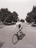 Businessman Riding a Bicycle Photographic Print by Philip Gendreau