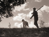 Hunter Walking with Bird Dog Photographic Print by Philip Gendreau