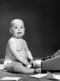 1950s-1960s Baby in Diaper Sticking Out Tongue Holding Glasses Sitting before Adding Machine Photographic Print