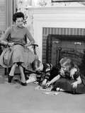 1950s Mother Watching Son Daughter Playing Game in Front of Fireplace Photographic Print