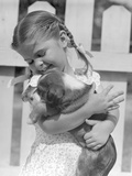1930s-1940s 1950S Little Girl with Braids Holding a New Puppy Dog Photographic Print