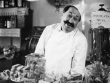 1930s Vintage Portrait of Smiling Proprietor Behind Counter in Coffee and Sweet Shop Photographie