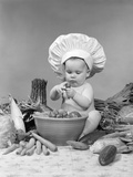 1950s-1960s Baby Wearing Chef Hat Toque Bowl and Raw Vegetables Making a Salad Photographic Print