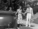 1930s Family of Four Getting into Convertible Automobile with Picnic Basket and Thermos Jug Photographic Print