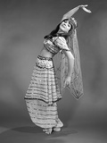 1960s Woman in Belly-Dancer Costume Stretching Back with Arms Out Photographic Print