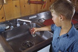 Boy Getting Glass of Tap Water Photographic Print by William P. Gottlieb