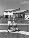 1950s Back View of Twin Girls in Plaid Skirts and Cardigans Holding Book Bags Photographic Print