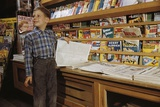 Boy Holding Paper in Newsstand Photographic Print by William Gottlieb