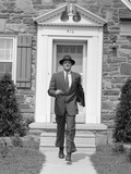 1950s Smiling Businessman Walking Out the Front Door of His House Photographic Print