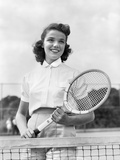 1940s-1950s Woman Posing with Tennis Racket on Tennis Court Near Net Fotografiskt tryck