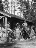 1920s-1930s Couple in Front of Log Cabin Woman Sitting on Porch Railing Man on Horse Alberta Canada Fotografiskt tryck
