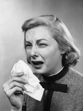 1950s Woman with Handkerchief Sneezing Indoor Photographic Print