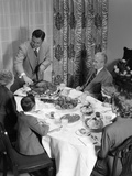 1950s 3 Generations Thanksgiving Dinner with Father Carving Turkey Photographic Print