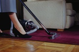 Woman Vacuuming Rug Photographic Print by William Gottlieb
