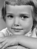 1960s Young Girl Posing with Arms Near Face Photographic Print
