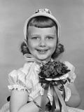 1950s Child Holding Flowers Smiling Photographic Print