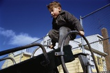Boy Playing on Playground Slide Photographic Print by William Gottlieb