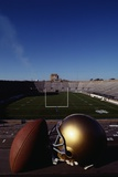 Notre Dame Football Helmet and Football at Notre Dame Stadium Fotografisk trykk av Paul J. Sutton