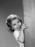 1960s Child Little Girl Smiling Peeking around Corner Photographic Print