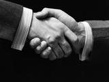 1930s Close-Up of Businessmen's Hands in Handshake Against Dark Background Photographic Print
