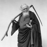 1930s Elderly White-Bearded Man in Long Robe Carrying Scythe and Hourglass Reproduction photographique