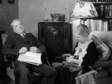 1930s Elderly Couple Sitting in Living Room Listening to Radio Photographic Print