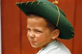 Boy in Cowboy Hat Making Funny Face Photographic Print by William Gottlieb