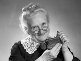 1950s Portrait of Senior Woman Putting Change into a Purse Photographic Print