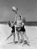 1950s Teens Jumping for Beach Ball Wearing Swim Suits Photographic Print