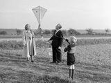Five Year Old Boy with Mother and Father Fly a Kite, Ca. 1951 Photographic Print