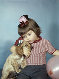 1950s-1960s Little Girl Wearing Party Hat Frowning Hugging a Cocker Spaniel Puppy Photographic Print