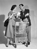 1950s Couple Man Woman Shopping Cart Reviewing Grocery List Man Has Cigar in Hand Photographic Print