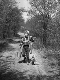 1950s Boy Beagle Puppy Walking Down Country Road Whistling Carrying Fishing Pole Pail Fish Stampa fotografica