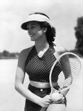 1930s Woman in Polka Dot Halter Top Shorts and Sun Visor Holding a Tennis Ball and Racket Fotografiskt tryck