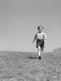 1930s Child Running on Grass Through Field Photographic Print