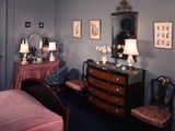1930s-1940s Bedroom with Blue Walls Pink Bedspread and Skirted Vanity Table Photographic Print by Ewing Galloway