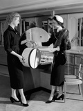 1950s Woman in Hat Stole and Gloves Taking Hatbox from Saleswoman Photographic Print