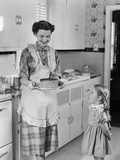 1950s Mother in Kitchen Showing Cake to Daughter Kitchen Photographic Print