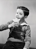 Smiling Boy with a Glass of Milk Photographic Print by Philip Gendreau