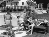 1960s Family in Backyard at Poolside, Father Barbecuing and Mother and Children Making Preparations Photographic Print