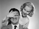 1950s Woman Standing Behind Man with Hand over His Eyes Photographic Print