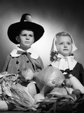 1950s Boy and Girl in Pilgrim Costumes with Harvest Arrangement on Table Photographic Print