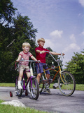 1960s-1970s Two Boys Riding Bikes in Park Summer Photographic Print